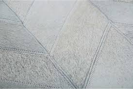 detail of a gray chevron leather area rug