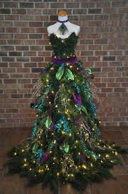 Christmas Tree Dress - Peacock inspired Christmas Tree gown on a mannequin.  600 lights and