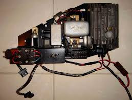 al alternator trouble wiring or ground pelican parts the 2 blue wires first go to the lower capacitor and then to regulator d 61 the black wire first goes to the upper capacitor and then the regulator df
