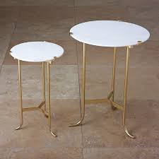 ask question about global views pile accent table in polished brass with a white marble top available in two diffe sizes selected sizes are on