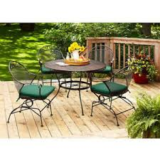 green cushion wrought iron chair table