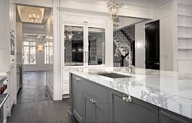 small kitchen with white and grey cabinetarble counter