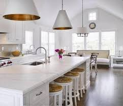 View in gallery Benson pendant lights bring an antique touch to this modern  white kitchen