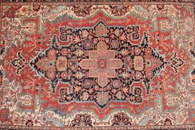 this is a fine and large antique heriz rug with a wonderful color palette and very