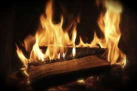 burning logs in wood burning fireplace