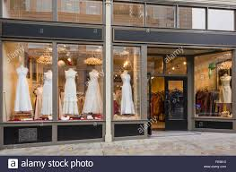 Exterior Of Bridal Boutique With Wedding Dresses Displayed In Shop