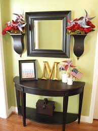 decorating small entryway table features half round dark wooden table and varnished wooden floor