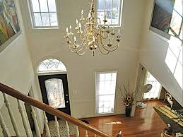 can light vs chandelier in foyer trgn 33f15c2521