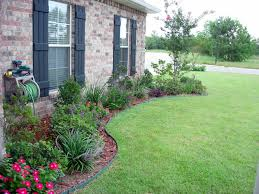 Outdoor, Interesting Green Rectangle Rustic Grass Flower Beds In Front Of  House Decorative Red Flowers