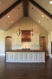 vaulted ceiling wood counter top island in kitchen parade of homes 2016