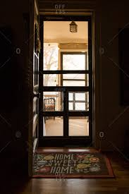 house front door open. Front Door Open To Porch With Home Sweet Doormat Stock Photo - OFFSET House Front