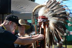 u s department of defense photo essay  rick ussery from the choctaw cherokee nation arranges ceremonial regalia of fallen warriors during the native