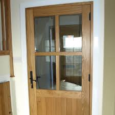 picture shows half glazed oak door with full astragals