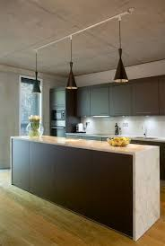 Track lighting pendants Directional An Easy Kitchen Update With Pendant Track Lights Pinterest An Easy Kitchen Update With Pendant Track Lights Deep Water Modern
