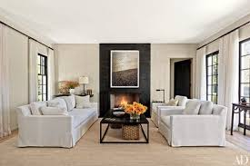 Living room interior design with fireplace Country Style Work By Jack Pierson Is Mounted On Blackenedsteel Fireplace Surround Fabricated By La Forge Française In The Living Room Of Southampton New York Architectural Digest Fireplace Ideas And Fireplace Designs Architectural Digest