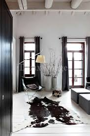 black and white cowhide area rug and nordic style room