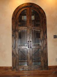 16 knotty alder true arch double doors with a hand sed finish and beveled glass
