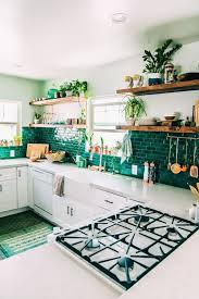 emerald subway tile backsplash makes up the whole kitchen decor