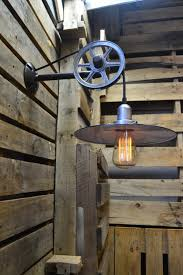 unique wall lighting. This Unique Wall Light Features An Edison Bulb On A Vintage Cloth-covered Cord Draped Over Metal Pulley. The Has Simple Shade Lighting L