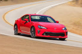 in a marketplace dominated by crossovers the 2018 toyota 86 shouldn t exist it s a promised loud rear wheel drive two door sports car
