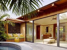 sliding glass doors open up leading into a stunning and soothing patio