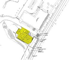 Windsor development wants to build a parking lot next to the retail space at the hamlet