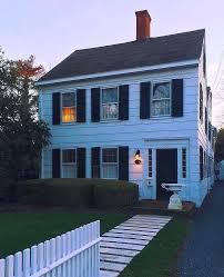 black vinyl shutters brick house black shutters red door grey house black shutters red door