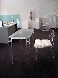 office interior design featured comfortable black wall to wall carpet plus simple acrylic desk and comfy acrylic office chair
