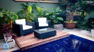 outdoor lily pond and deck sitting area caribbean furniture