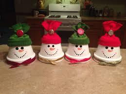 Snowmen made from small terra-cotta pots!