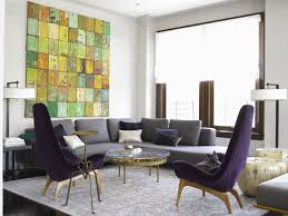 Love the artwork and the purple chairs. Gray and purple living room.