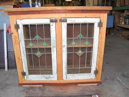 here are two views of small cabinet with double leaded glass doors antique hardware doug fir sides top and face frame