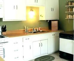 sage kitchen cabinets maple cabinetry in and mushroom with cocoa glaze traditional green white appliances