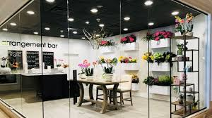 retail roundup upscale florist opens at garden city hotel