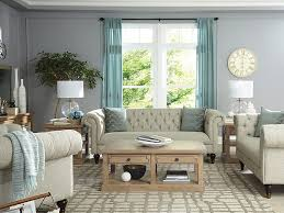 neutral living room with light blue accent colors