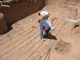 juan started on the spa while the two helpers started in the pool typically they start out by laying steel in one direction spaced 12 apart