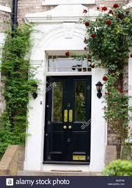 black double front doors. Plain Black Closeup Of Climbing Rose Above Black Halfglazed Double Front Door  Victorian House In Black Double Front Doors