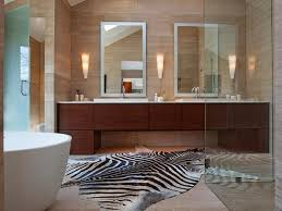zebra cowhide unique rug for elegant bathroom ideas with white framed mirrors and solid wooden vanity