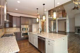 the kitchen opens into the two story great room for a contemporary open concept mountain home design