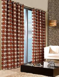 stylish trendy ringtop eyelet lined circle pattern curtains terracotta orange colour
