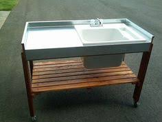 garden sinks. DIY Outdoor Garden Sink That Hooks Up To Your Faucet. Can Double As A Potting Bench. Sinks