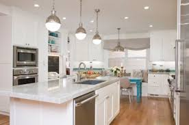 lighting kitchen that blends ample natural ventilation with smart pendant lighting