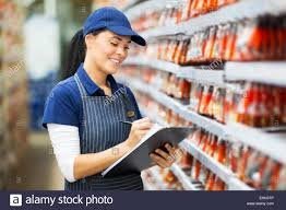 beautiful young hardware store worker stock taking stock photo stock photo beautiful young hardware store worker stock taking