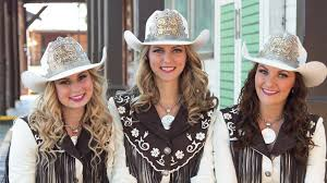 calgary stampede annual report cs family queen maggie shortt or naheed nenshi princess bailee billington and princess chelsey jacobson