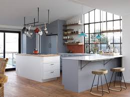floating shelves above part of the counter in this kitchen keep the everyday plateugs at arms reach so they re easy to grab and go