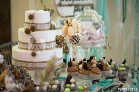 Wedding Cake With Cupcakes At The Exhibition Buy This Stock Photo