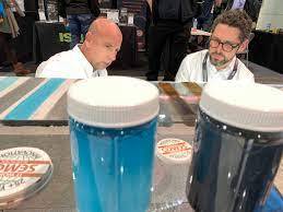 Adam Nitte with Semco Modern Seamless Surface, right, talks to Robert Polo  of Valencia, California, at his booth at the World of Concrete trade show  at the Las Vegas Convention Center Thursday,