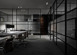 the main office space does away with unnecessary partitions in favour of an open plan layout incorporating two stand alone work stations overhead office lighting