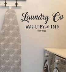 wash dry fold repeat laundry room wall