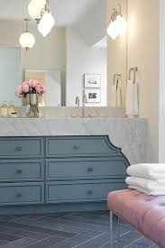 blue bathroom floor tiles. Pink And Blue Bathroom Features A Washstand Topped With Curved Carrera Marble Under Sconces Lining Frameless Mirror Atop Gray Slate Herringbone Floor Tiles